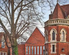 Bell Phillips has completed a red-brick extension to a grammar school in Kent, England, featuring gabled facades and architectural details that reference its historic surroundings. Brick Extension, Tunbridge Wells, Grammar School, School Building, Brickwork, Red Bricks, Victorian Gothic, Architecture Details, Exterior
