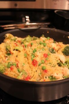 Spaghetti squash with grilled chicken, sundried tomatoes, broccoli, and peas