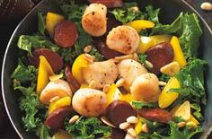 Seafood and Spanish sausage with kale