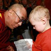 His Holiness The 14th Dalai Lama greets a young well-wisher in Maribor, Slovenia.