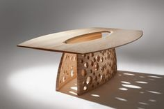 Designed by John Lee, this table is made of solid ash that have been textured and sandblasted. Inspired by eroded sedimentary rock and the effects of erosion, the legs is come with many sculptural holes, give a sense of light and airy. At the center, it has an abyss that connected to the legs.