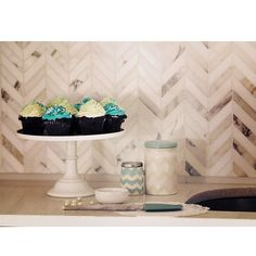 This chevron pattern with classic White Carrera & elegant Thassos polished marble mosaic will provide endless design possibilities, from contemporary to classic, and will serve as a great focal point to suit a variety of settings. Shop these tiles and more at TileBar.com!
