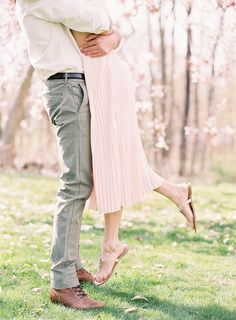 Sweet engagement session amongst magnolia trees.
