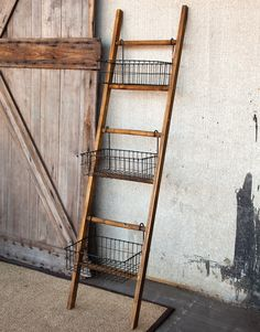 Not a ladder used for reaching the out of reach. Conveniently it serves to keep daily needs right in front of your eyes. Seventy two inch tall wood ladder leans against the wall and offers three graci...                                                                                                                                                                                 More
