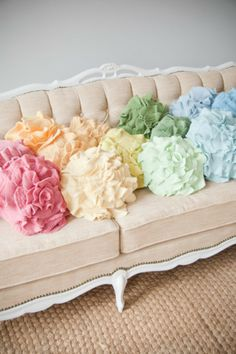 What lovely pastel colored flower pillows!