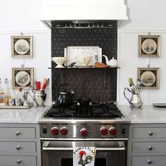 An Exquisite Kitchen Renovation Has Charm To Burn - laurel home | come see the fabulous kitchen by Nancy Keyes and get the formula for her custom paint color! Fabulous gray cabinets - Decorator's white walls