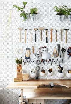 This could be a cute way to cover the walls in the mudroom - hang plants and baskets with garden tools