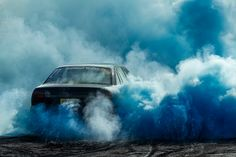 cars consumed by colorful plumes of smoke are the subject of australian photographer simon davidson's series 'burnouts'.