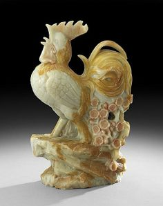 """Chinese Soapstone Carving, 20th century, the yellow and orange stone carved in the form of a cockerel with flowering plum branch, h. 18""""."""