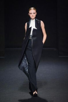 Stephane Rolland F/W 2013 - 2014 Couture   Purtian colors of black and white with modest falling band covered