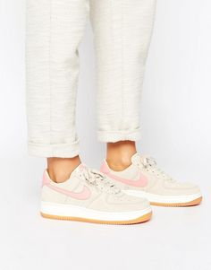 low priced 8e355 9e6f6 Shop Nike Air Force 1 Trainers In Beige And Pink at ASOS.