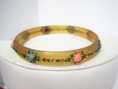 VintagObsessions presents this lovely Art Deco celluloid bracelet from the 40's era. Hand painted an