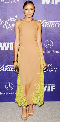 Ashley Madekwe arrived at the Variety and Women in Film Emmy Nominee Celebration in a copper silk crepe Wes Gordon dress with yellow vine lace insets, with slick gold jewelry, a metallic clutch, and nude Stuart Weitzman sandals.