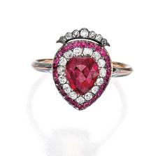 SILVER, GOLD, RUBY AND DIAMOND RING The crowned heart centering a heart-shaped ruby measuring approximately 7.3 by 6.7 mm, framed by old mine-cut diamonds weighing approximately .35 carat, accented by round rubies, size 6; circa 1820.