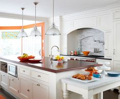 Love the arch above the cook top that hides the vent hood