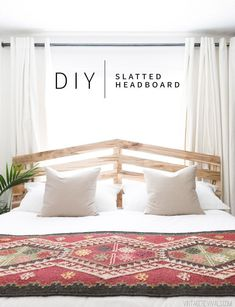 This DIY $70 Slatted Headboard adds so much fun character to this Scandinavian, boho bedroom. | Vintage Revivals #diybedroom #bohobedroom #diyhomedecor