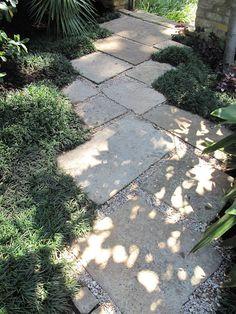 Stone or concrete pavers as a garden path