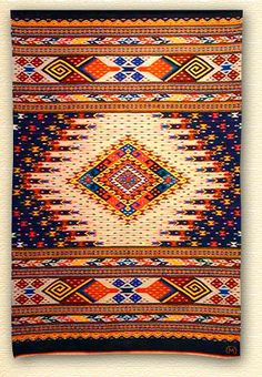 Weaving by Arnulfo Mendoza of Oaxaca, Mexico.  I love his designs and colors!