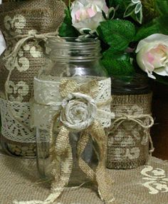 This simply beautiful burlap design is compatible with any glass holder..works well with candles, The glass jar is accented with a brown burlap, & a handmade Victorian swirls jute rose. This rose ties on the beautiful 2 inch wagon wheel vintage lace..All quality from banner banquet..
