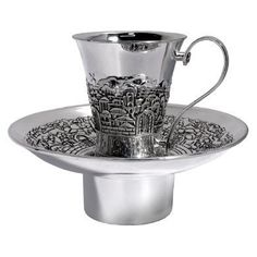 """Jewish Mayim Achronim - Old City of Jerusalem Motif by Legacy. $39.94. Use this Mayim Achronim set to wash hands before saying the Birkat HaMazon (Grace After Meals). Lovely no tarnish nickel plate has all the shine of silver with no polishing required. Cup stands 3.25"""" tall and measures 2.75"""" in diameter. Basin measures just under 6"""" in diameter. Comes boxed."""