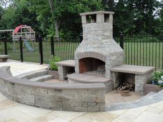 Fire Features (2) Natural stone veneer fireplace with sitting bench.jpg 800×600 pixels