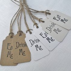 pack of five 'eat me' or 'drink me' tags by yatris home and gift   notonthehighstreet.com