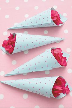 Guests will love these easy-to-make spotted confetti cones. Cut spotted paper into 15cm squares with scissors. Roll each square into a cone and glue along the inside edges. Fill with rose-petal confetti.
