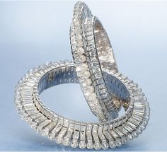 Viren Bhagat - Diamond bangles that appears to float and have no trace of metal.
