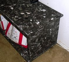 Used mod podge and scrapbook paper to give a little life to a boring TV stand.