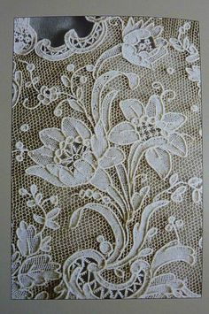 Nice example of needlelace.  I believe it's a form of Rose Point from the layered flower on the left. #lace #rosepoint Musée de la dentelle à Alençon (1)