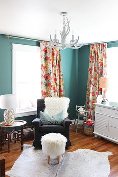 Rosie's New Nursery Colorful and eclectic nursery for a little girl with dark green walls, gorgeous floral curtains, and a cowhide rug Teal Nursery, Floral Nursery, Nursery Decor, Bedroom Decor, Project Nursery, Nursery Ideas, Nursery Curtains Girl, Bright Nursery, Boho Nursery