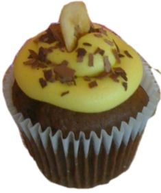 "Cheeky Monkey Cupcake - Banana Flavored Chocolate Cake Topped off with Banana Flavored Butter Cream Frosting, Chocolate Shavings & a Banana Chip    ""A flavor you'll go Ape for"""