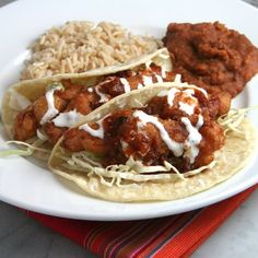Rick Bayless' Classic Ensenada Fish Tacos- made with crispy beer-battered fish & drizzled with a fabulous creamy garlic sauce.
