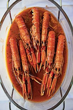 On Croatia's Dalmatian coast, shellfish are often prepared na buzaru, simmered in a brandy-and-wine-enriched tomato sauce. Langoustines are used here, but the preparation works just as well with shrimp, clams, or mussels.