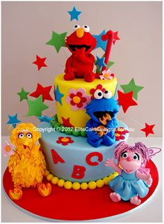 Sesame St Elmo Birthday cake for kids. I would love this cake as a bright colourful and FUN wedding cake. Love the colourful Sesame Street characters :)