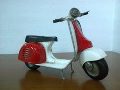 Moto-Vespa metal 21´00 € ($17,50)