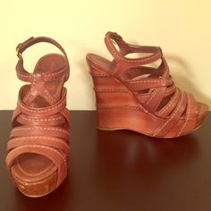 Authentic Miu Miu brown leather wedges Authentic Miu Miu brown leather wooden wedges with white stitching. Size 38. Good used condition. Adjustable ankle strap. 1 1/2 inch platform, 5 1/2 inch wedge. Scuffing on soles and in front of shoe. Very comfortable. Miu Miu Shoes Wedges