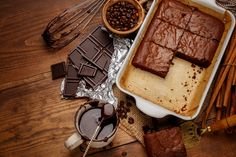 Chocolate coffee cake sitting in a glass cake pan with parchment paper and surrounded by melted chocolate and coffee beans. Chocolate Cake With Coffee, Coffee Cake, Melting Chocolate, Chocolate Cakes, Ghee Coffee, Coffee Beans, Cocoa Brownies, Glass Cakes, Sem Lactose
