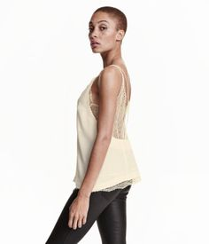 V-neck, open-back camisole top in woven fabric and an inner layer of lace. Narrow straps crossed at back.