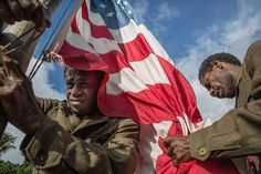 """Members of John Frum movement raise an American flag during the celebration of John Frum day in Lamakara village on Tanna Island, Vanuatu.  Cargo cults…"""
