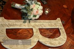 "Wooden ""B"" letter makes a fun alternative to a traditional wedding guest book 