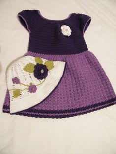 GlobeIn: This handmade dress with hat is perfect for your baby girl.