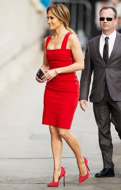 Jennifer Lopez in a red bodycon dress and red pumps