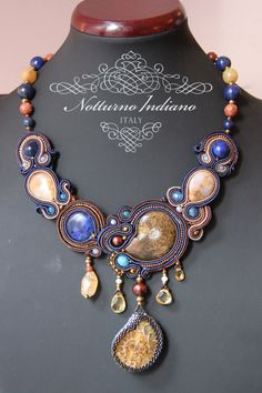 handmade soutache necklace created with ammonite, fossil coral and lapis lazuli Very elegant and unique, this is the kind of necklace every woman would envy you when wearing it!  On the back it is lined with velour.   OOAK