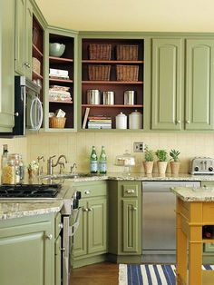 Less Is More ~ Removing the doors from some of the upper cabinets reveals the space inside, making the kitchen look larger. Paint the interior a rich accent color to spice up the kitchen even more.