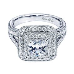 14K White Gold 2.25cttw Double Halo Princess Cut Diamond Engagement Ring. This classic style ring features .96cttw of round diamonds bead set in a double halo with additional bead set round diamonds i