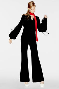 A bell-sleeved blouse and leg-lengthening flares: sexier than a jumpsuit, slinkier than a cocktail dress.