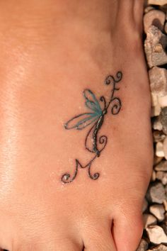 Love the Idea of incorporating kids initials my mom got a butterfly on her foot and put mine and my siblings initials on it