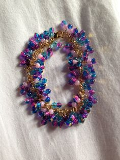 Pink & blue crackle glass beaded charm bracelet on gold chain!    Price: £8   Warning: Please keep this bracelet dry at all times! Do not wear it in the shower or continuous water use!
