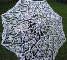 Starting Chain - Here is a picture of a crocheted parasol I made last year. The pattern started as a doily (pineapple vintage something) but I used a larger hook. It took me two months to complete.